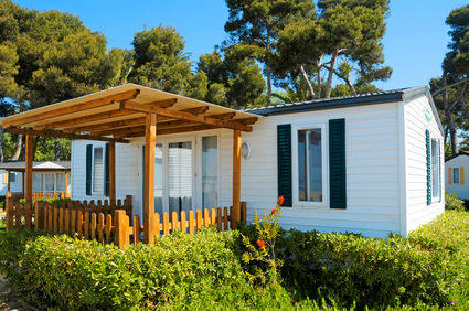 Mobile home with small porch that can be replaced with stick-built home