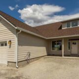 tan double story home with brown roof on your lot build